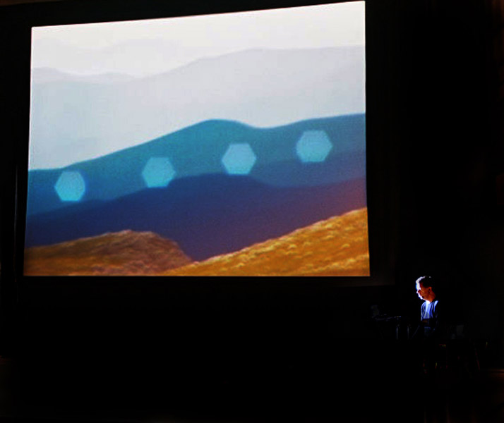 Nicholas Isherwood Performing David Felders Work Shemayin In Front Of The Projection Of Film By Elliot Caplan  3