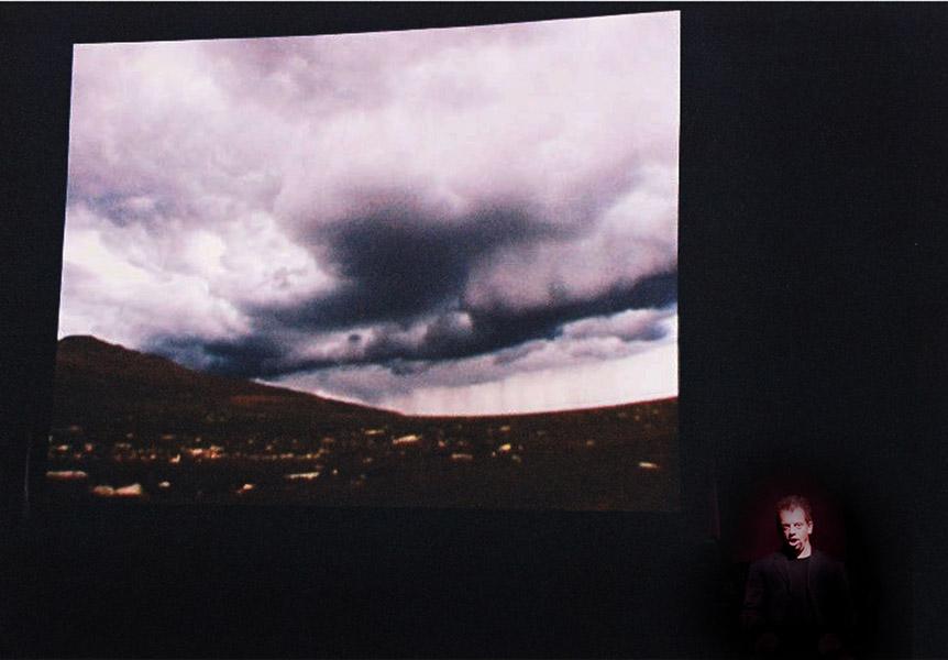 Nicholas Isherwood Performing David Felders Work Shemayin In Front Of The Projection Of Film By Elliot Caplan  4